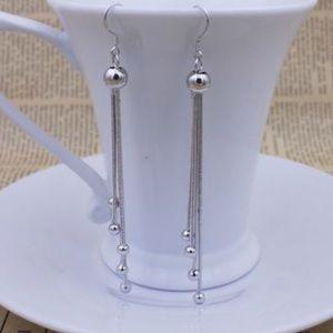 Dangling 925 Sterling Silver fashion earrings.